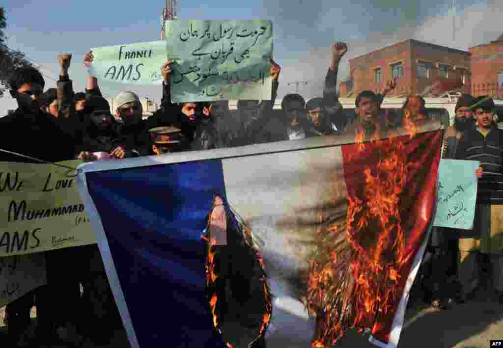 Pakistani demonstrators  in Peshawar burn the French flag during a protest against the printing of satirical sketches of the Prophet Muhammad by Paris-based magazine Charlie Hebdo. (AFP/A Majeed)