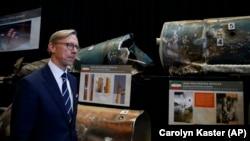 Brian Hook, U.S. special representative for Iran, walks past fragments of Iranian short-range ballistic missiles at a base in Washington, D.C., on November 29.