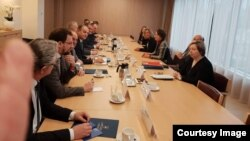 Kosovar negotiators meet with the EU's Federica Mogherini in Brussels on January 8.