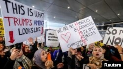 Demonstrators rally against the immigration rules implemented by U.S. President Donald Trump's administration at Los Angeles International Airport last month.