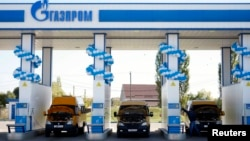 Vehicles are seen at a gas filling station, owned by Gazprom Transgaz Stavropol, with the company logo of Russian natural gas producer Gazprom on the station, in Stavropol