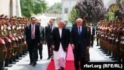 Afghan President Ashraf Ghani (right) welcomes German counterpart Frank-Walter Steinmeier to the Gulkhana-Palace in Kabul on July 13.