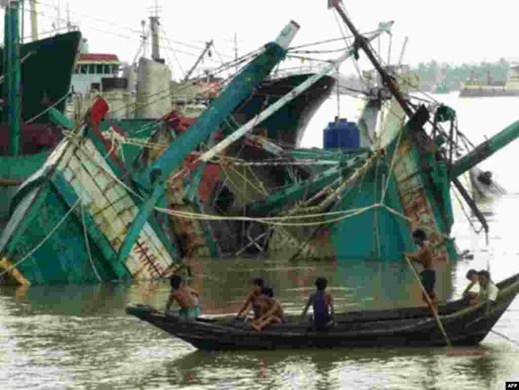 Myanmar hit by tropical cyclone Nargis - Destroyed fishing boats lay in the port of Yangon after cylone Nargis on May 4, 2008. Myanmar residents awoke to devastation after tropical cyclone Nargis tore through swathes of the country, battering buildings, sinking boats and causing unknown casualties.