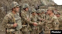 Armenia - Defense Minister Seyran Ohanian meets soldiers on frontline duty on the border with Azerbaijan, 5Aug2013.