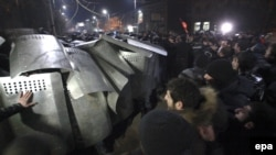 Armenia -- Armenian people clash with police during a mass protest outside the Russian Consulate General in the city of Gyumri, Armenia, 15 January 2015.
