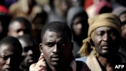 African refugees wait at a makeshift camp near the Libyan port city of Misurata on March 31.
