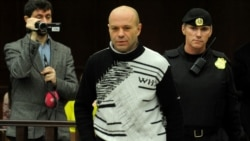 Dmitry Pavlyuchenkov (center) is escorted into a Moscow courtroom on December 14.