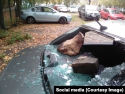 Earlier this month, local lawmaker Vitaly Tretyukhin found the rear window of his car smashed with a brick and a severed pig's head left behind.