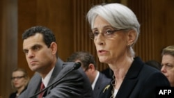 U.S. State Department Under Secretary For Political Affairs Wendy Sherman alongside her counterpart from Treasury, David Cohen, at an appearance before the Senate Foreign Relations Committee in late July.