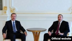 Azerbaijani President Ilham Aliyev (right) meets with Turkish Prime Minister Recep Tayyip Erdogan in Baku.