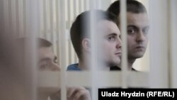 The three defendants (from left to right): Yauhen Baranouski, Anton Vyazhevich, and Yahor Skuratovich
