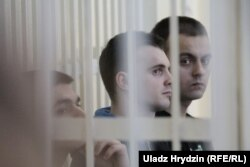 Абвінавачаныя ў справе Коржыча Яўген Бараноўскі, Антон Вяжэвіч і Ягор Скуратовіч