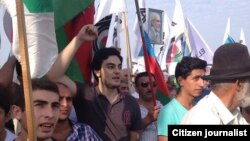 Azerbaijani opposition leader Ali Kerimli's son Turkel attends an opposition rally in Baku on September 22.