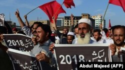 Supporters of Awami National Party (ANP) protest against alleged election rigging in Peshawar on July 30.