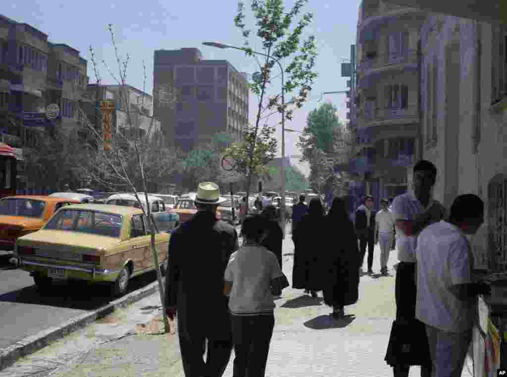 A street scene showing pedestrians on a sidewalk, June 16, 1970, Tehran, Iran. (AP Photo/Roy Essoyan)