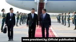 Chinese President Xi Jinping is greeted by his Kyrgyz counterpart, Sooronbai Jeenbekov, on a state visit to Bishkek last year.