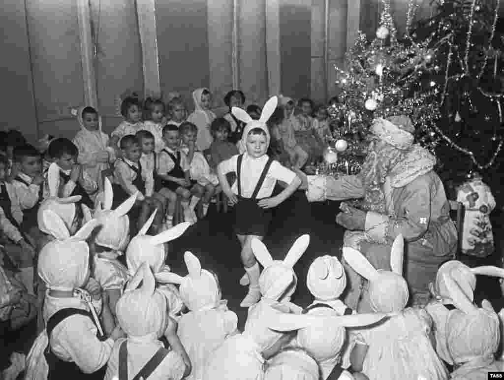 A New Year's celebration in a kindergarten in 1963. While Christmas is the most popular day for gift-giving and merrymaking in most of the Christian world, Russia's biggest such celebration is on December 31, when Xmas traditions meet the champagne-soaked partying of New Year's Eve.