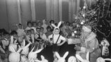 A New Year's celebration in a kindergarten in 1963. While Christmas is the most popular day for gift-giving and merrymaking in most of the Christian world, Russia's biggest such celebration is on December 31, when Xmas traditions meet the champagne-soaked partying of New Year's Eve.<br />  <br />  <br />