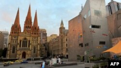 A file photo shows part of Federation Square (right) and St. Paul's Cathedral (left) in Melbourne.