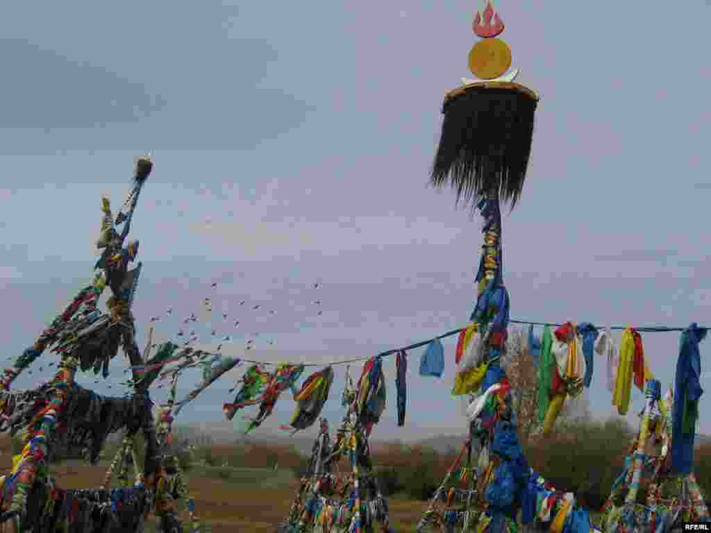 A roadside shaman shrine south of the Mongolian capital. - Even more than Buddhism, shamanism is the guiding spiritual tradition among traditional nomadic tribes in Mongolia, Central Asia, and Siberia. Mongolian drivers will typically beep their horn when passing a shrine. (Photographs by Daisy Sindelar)