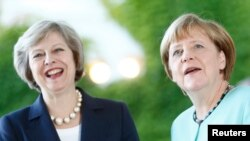 Angela Merkel və Theresa May