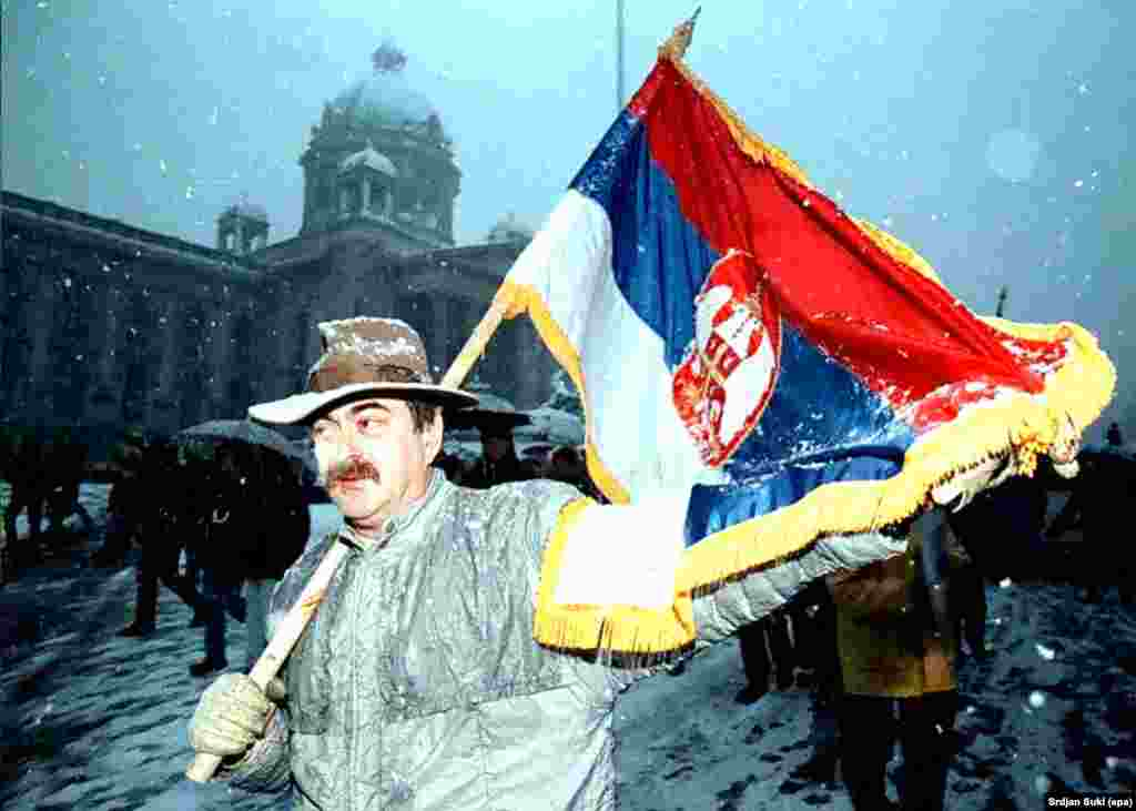 A Serbian protestor demonstrates against President Slobodan Milosevic in front of the parliament building in Belgrade in 1996.