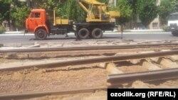 Uzbekistan - workers are demolishing tramline in Tashkent