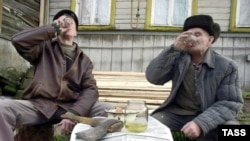 Men drinking home made alcohol in Russia's Ivanovskaya region