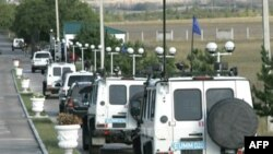 EU vehicles leave a base in the Georgian town of Mukhrani for cease-fire monitoring in October 2008, just two months after the brief Georgia-Russia conflict.