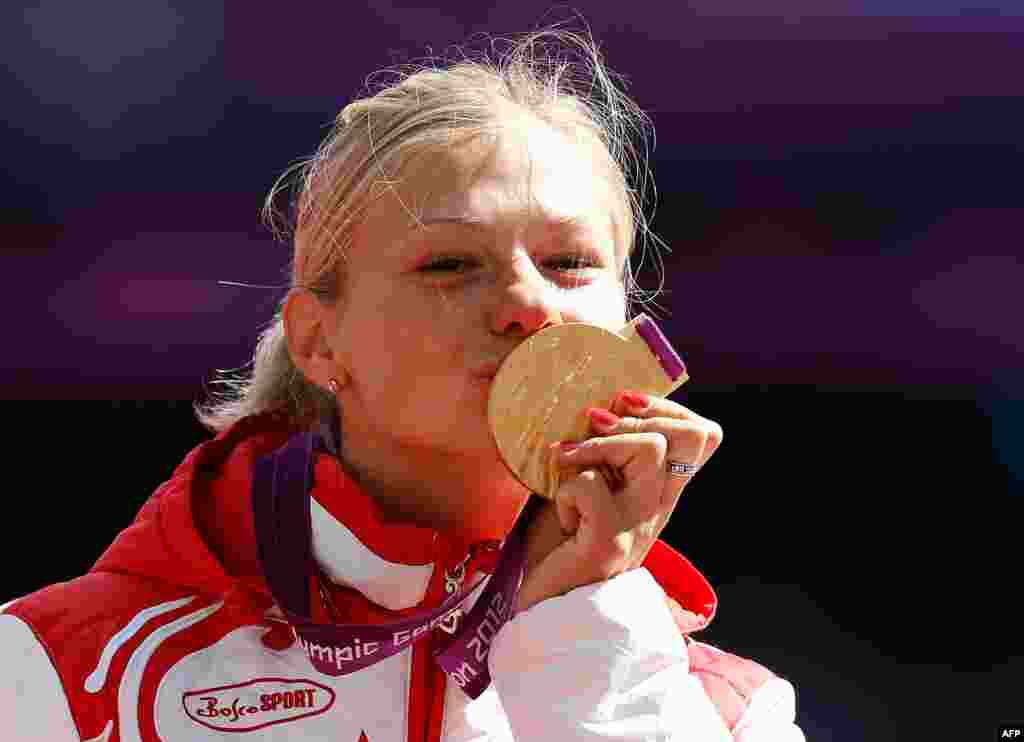 Russia's Margarita Goncharova poses with the gold medal after winning a women's long jump event.