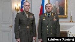 U.S. General Joe Dunford (left) and Russian General Valery Gerasimov at a meeting in 2018 in Finland