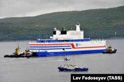 Russia's floating nuclear power plant, the Akademik Lomonosov, leaves the service base of Atomflot for a journey along the Northern Sea Route to Chukotka from Murmansk on August 23.