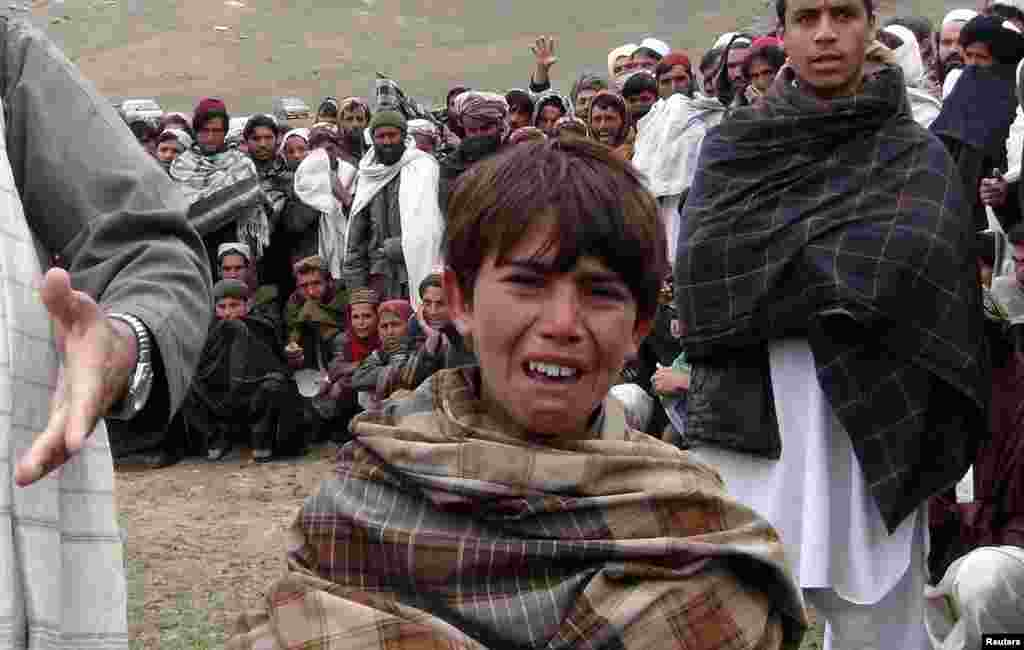 A boy cries during a funeral of members of his family in Afghanistan's Logar Province. (Reuters)