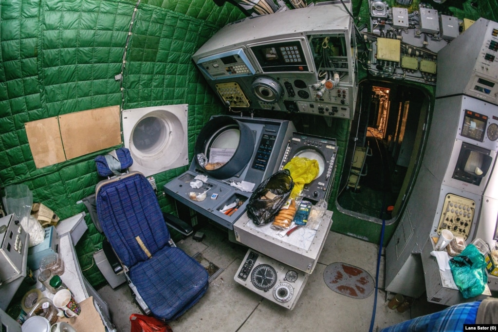 """A radar operator's station: Sator says some places in the Lun were cluttered with """"chicken and cakes"""" left by the men working on readying the vessel for public display."""