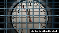 Generic - ©Shutterstock photo. Locked schedule business concept and doing time behind bars with a time clock confined away in prison as a symbol of schedule management and locking in dates for special events during days and weeks, undated