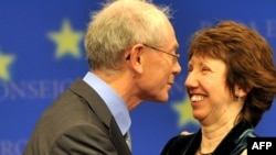 Belgian Prime Minsiter Herman Van Rompuy, the EU president-elect, kisses EU Trade Commissioner Catherine Ashton, who will head the High Representative for Foreign Affairs, after their selection on November 19.