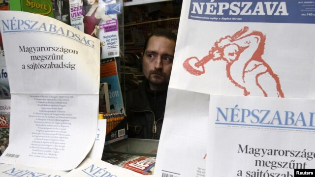 Two Hungarian dailies carried protests on their front pages against the new media law in Budapest on January 3, 2011: