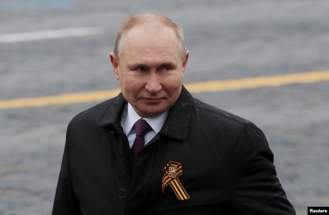 Russian President Vladimir Putin walks along Red Square after a military parade on May 9.