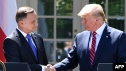 U.S. President Donald Trump (right) and Polish President Andrzej Duda shake hands after holding a joint press conference at the White House in Washington, D.C., on June 12.
