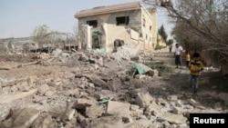 Алеппо маңындағы елдімекендердің біріндегі әуе шабуылынан қираған үй. 21 қазан 2015 жыл.