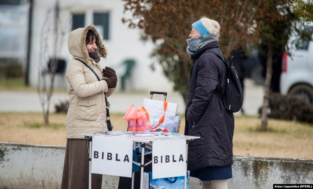 Women at a stand displaying Bibles in Prizren. Christians in Kosovo are a small minority, with around 95 percent of the population identifying as Muslim. (Photo by Basri Oruqaj)