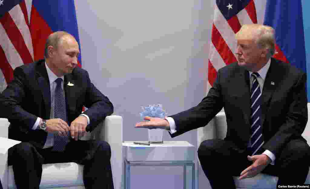 Russian President Vladimir Putin meets U.S. President Donald Trump during their first meeting, at the G20 summit in Hamburg, Germany, July 7, 2017. (Reuters/Carlos Barria)