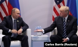 Ресей президенті Владимир Путин мен АҚШ президенті Дональд Трамп. Гамбург, 7 шілде 2017 жыл.