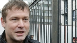 Leonid Razvozzhayev speaking to journalists outside the police investigators' offices in Moscow on October 11.