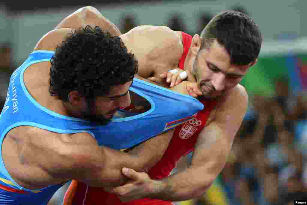 Davor Stefanek of Serbia and Migran Arutyunyan of Armenia compete in the final of the men's Greco-Roman 66-kilogram wrestling. Stefanek took gold.