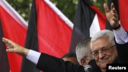 Palestine -- President Mahmud Abbas waves to the crowd during a celebration in the West Bank city of Ramallah, 25Sep2011