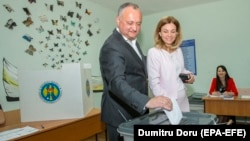 Moldovan President Igor Dodon (left) casts his ballot with his wife at a polling station during local elections in Chisinau on May 20.