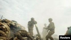 File photo of U.S. soldiers firing a mortar in eastern Afghanistan.