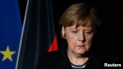 France -- German Chancellor Angela Merkel attends a news conference in Seyne-les-Alpes March 25, 2015.