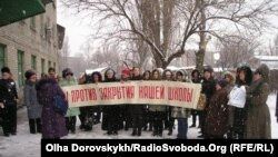 Parents and teachers protest against the closing of a Ukrainian language school in Donetsk.